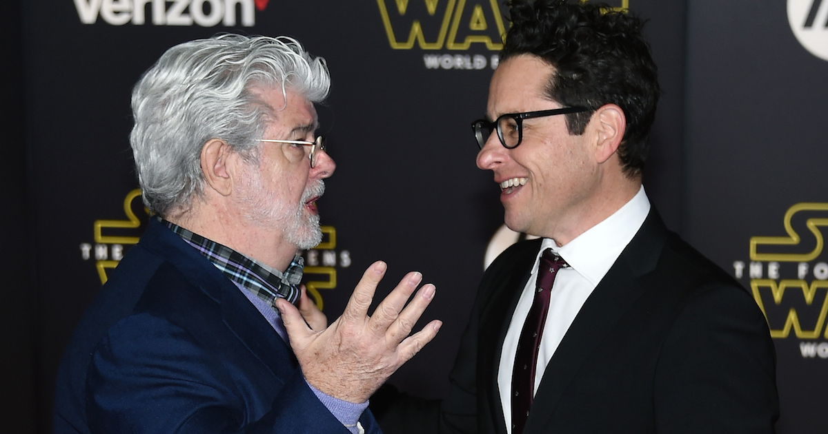Star Wars creator George Lucas and The Force Awakens director J.J. Abrams talk during the world premiere, probably about football or something.