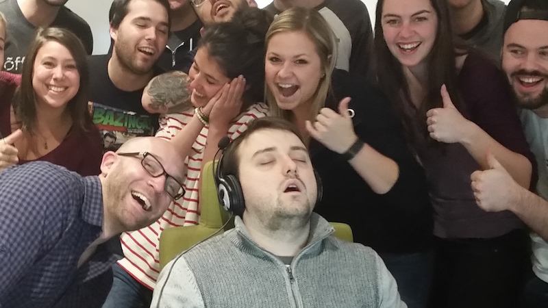 guy who fell asleep at work and got photobombed by his