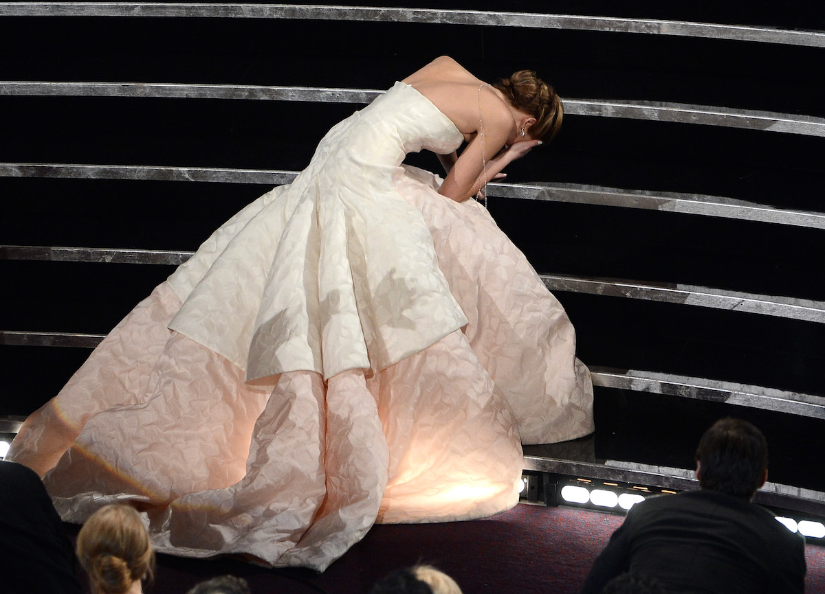 Jennifer Lawrence after falling down while walking up to accept her Oscar, or possibly just doubled over from cramps.