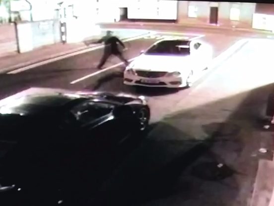 Guy throws a brick at a car and gets a delightful surprise.