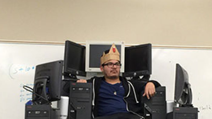 Power-mad IT geek builds throne of PCs.