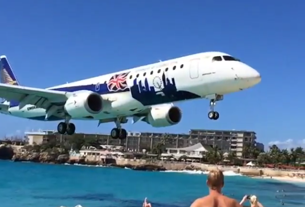 Passenger jet flies so low over a beach it could spike a volleyball.