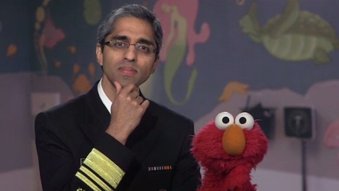The Surgeon General teaches Elmo about vaccines and throws shade at anti-vaxxers.