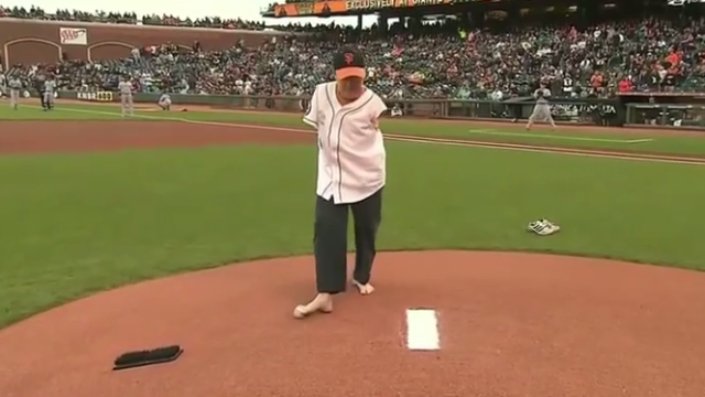 This man with no arms throws a better first pitch than 50 Cent. And many pitchers.