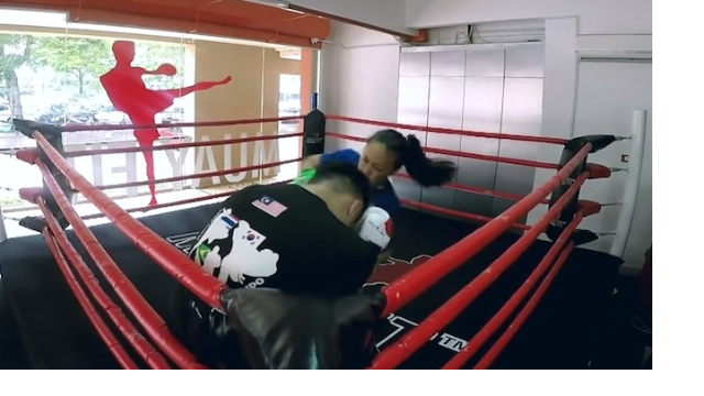 A championship fighter disguised as a nerdy girl surprised her trainer with a swift ass-kicking.