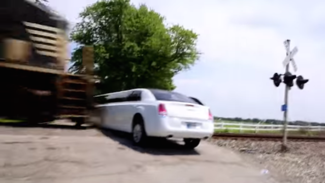 Watch this speeding train crash into an empty stretch limo because prom 2k15 is crazy!!!