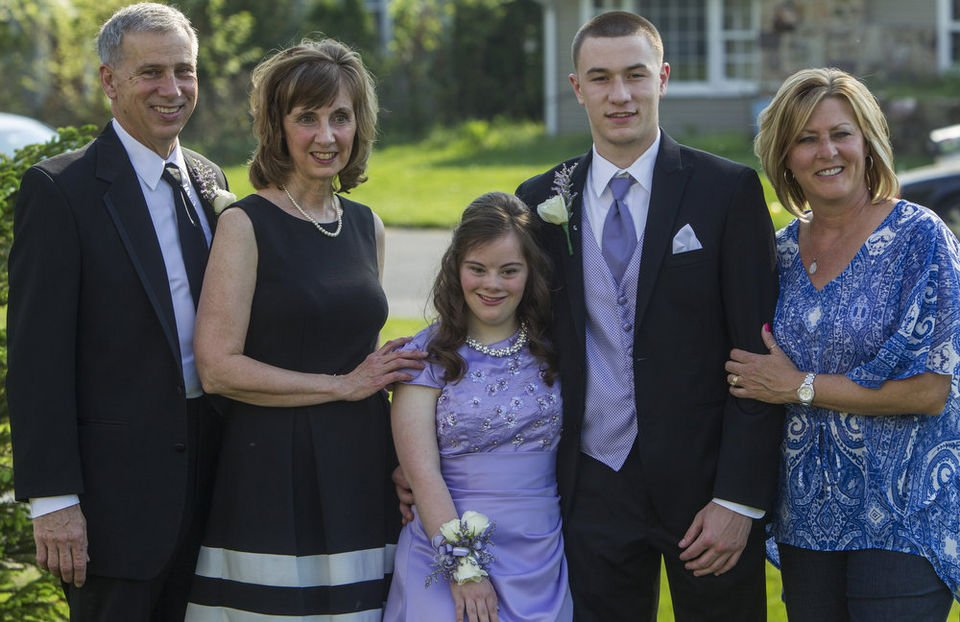 High school quarterback takes friend with Down syndrome to prom after asking her in fourth grade.