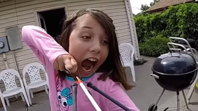 An 11-year-old uses a bow and arrow to remove her tooth.