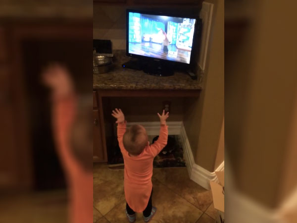 This baby girl gets so hyper when she sees a dancing reindeer on television.