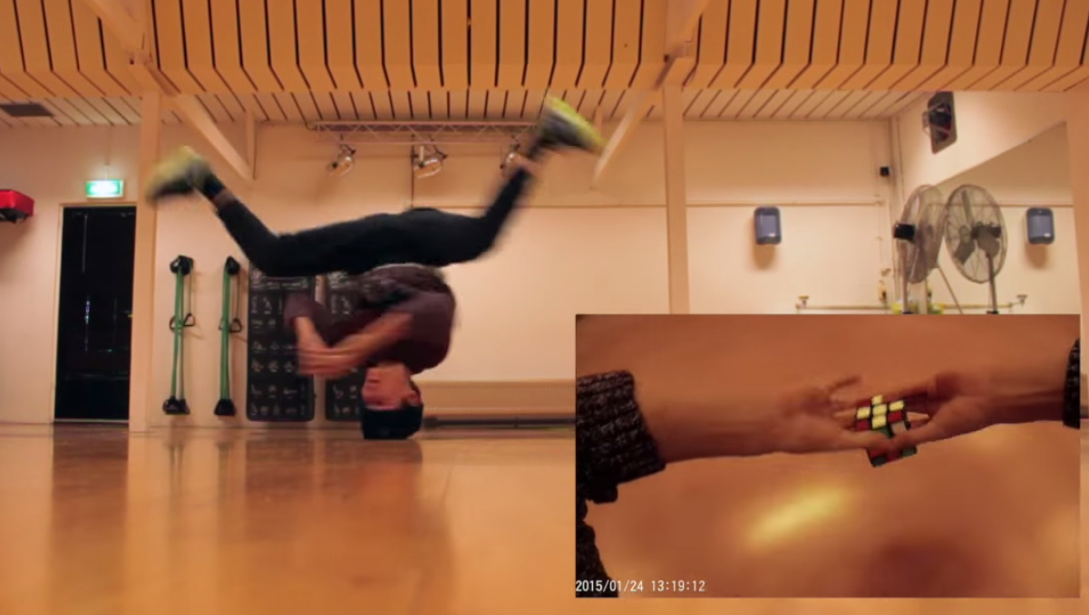 Overachiever alert: 14-year-old breakdancer solves Rubik's Cube while spinning on his head.