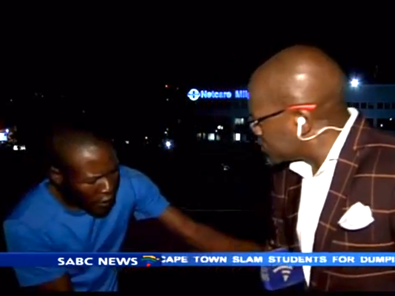 Reporter mugged at gunpoint on camera while waiting to go on air.
