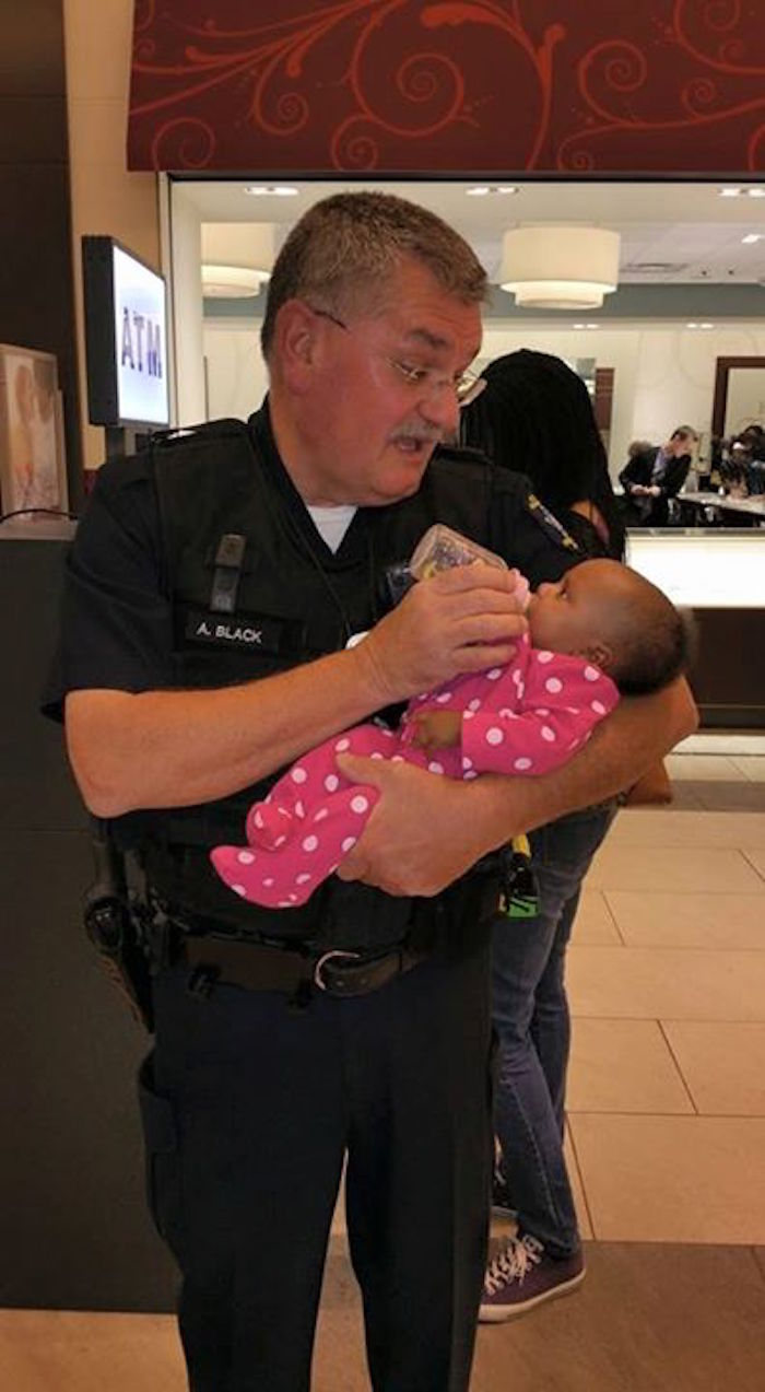 Awesome cop caught on camera answering the call of duty...and hungry babies.