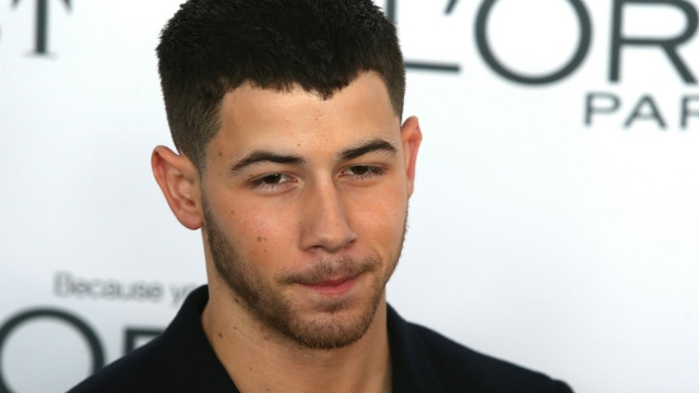 15 of the funniest tweets about the food stuck in Nick Jonas' teeth at the Grammy's.