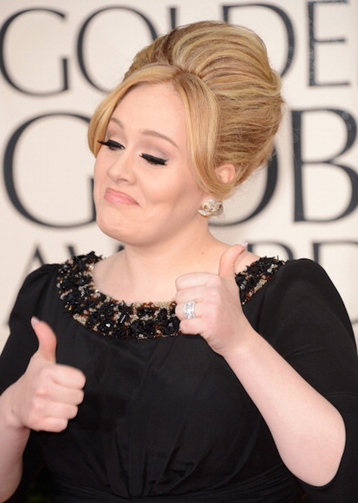 Adele's people won't let her post her own tweets for booze-related reasons.