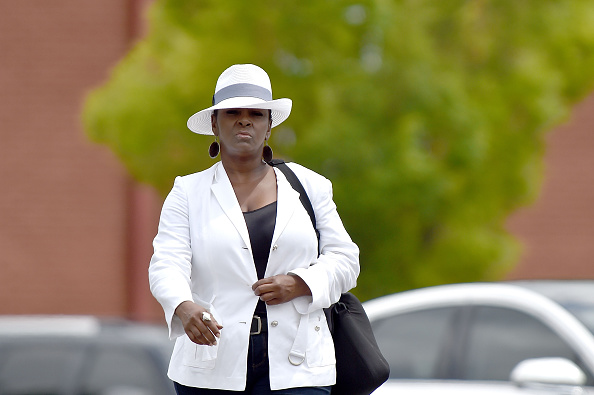 Tyler Perry presents escorting Leolah Brown from Bobbi Kristina's funeral.