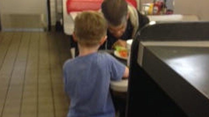 """""""Get as much bacon you want"""": Generous 5-year-old boy helps hungry homeless man at a Waffle House."""