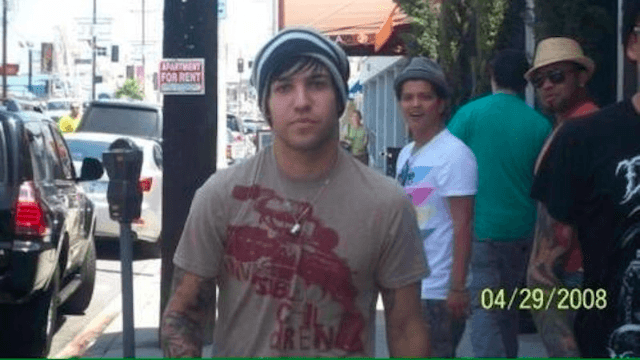 It's the 9th anniversary of the day Bruno Mars photobombed Pete Wentz—but now the true story is out.
