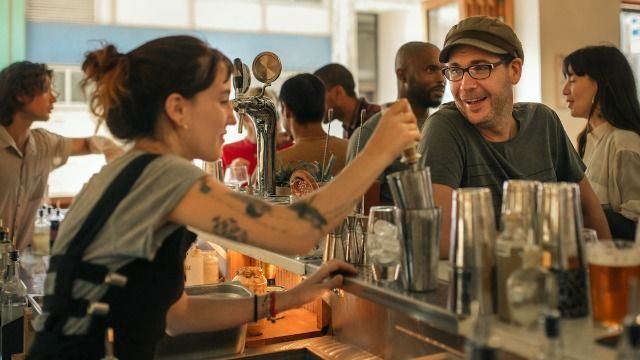 A restaurant's choice to split a customer's $16,000 tip between the staff sparks debate.