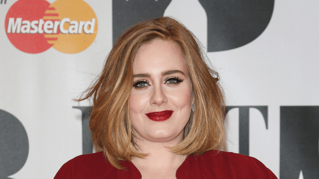 After Adele forgets her lyrics at a Lisbon concert, her foul-mouthed reaction will make you want to hug her.