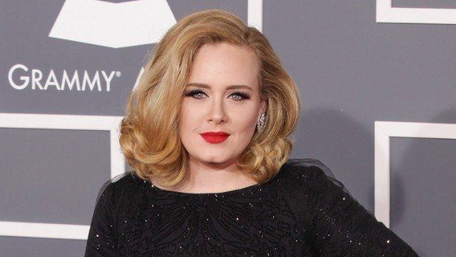 Adele's personal trainer writes post defending her after fans criticize her weight loss transformation.