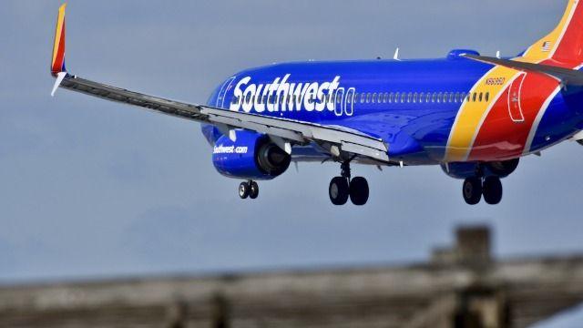 People react to viral video of Southwest passenger punching flight attendant.