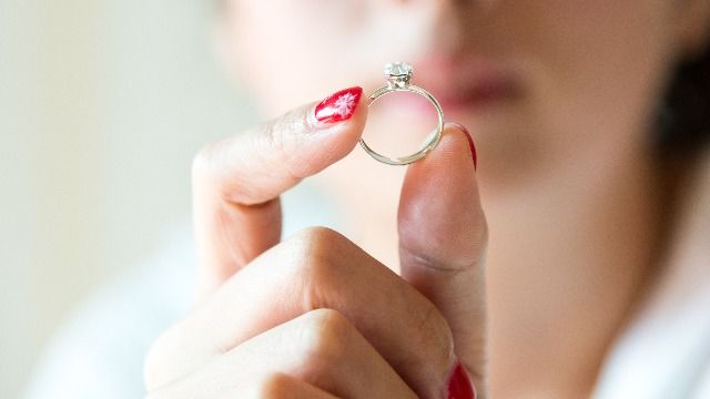 Woman asks if it's wrong to sell engagement ring after ex won't return her stuff.