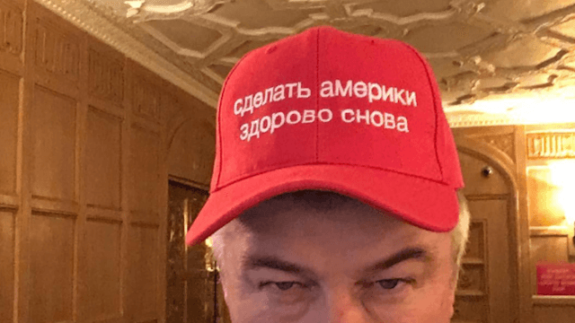 Alec Baldwin just keeps trolling Trump, this time with a Russian 'Make America Great Again' hat.