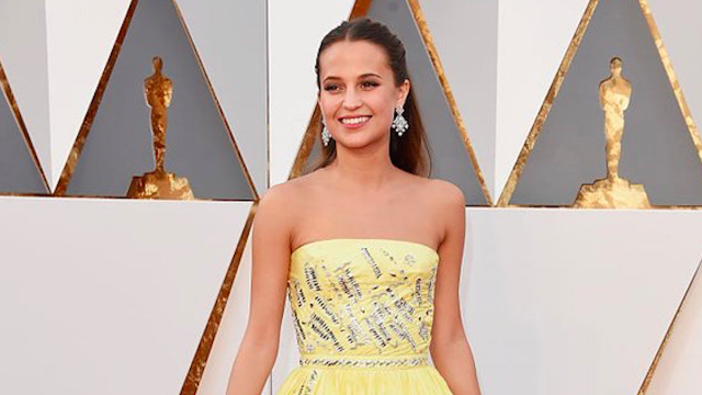 Alicia Vikander is the Belle of the ball with a Disney Princess-inspired look at the Oscars.