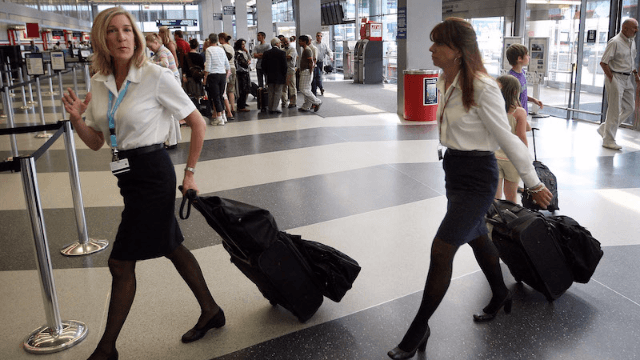 Thousands of American Airlines flight attendants say their new uniforms are making them sick.