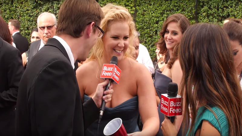 Amy Schumer and other celebs played Flip Cup on the Emmys Red Carpet to remind you that it's basically a frat party.