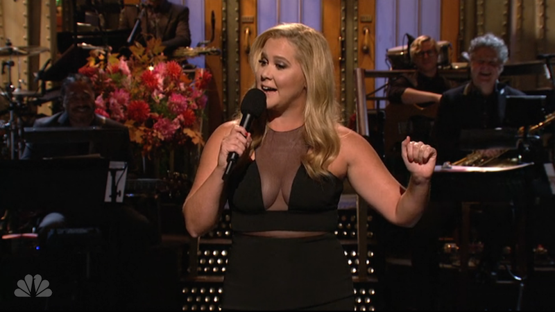 Amy Schumer talks role models for young girls, dating Bradley Cooper in her 'SNL' monologue.