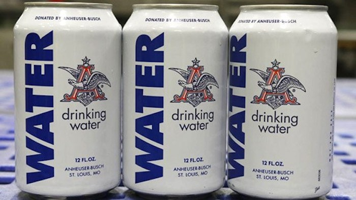 Anheuser Busch converts brewery to supply drinking water for flood victims.