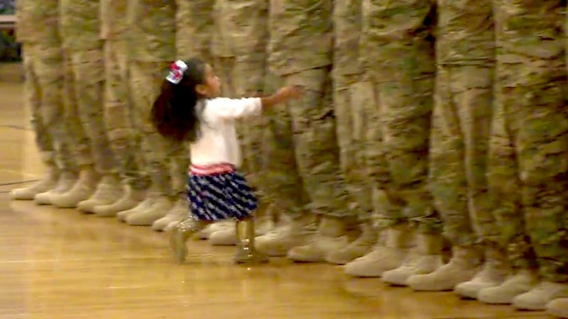 Watch this girl hug her dad during his Army ceremony and remember you have feelings.