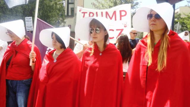 Polish 'handmaids' confronted Trump with two things he hates: literature and protest.