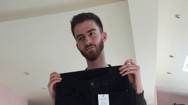 Guy receives jeans he ordered online and laughs and laughs and laughs.