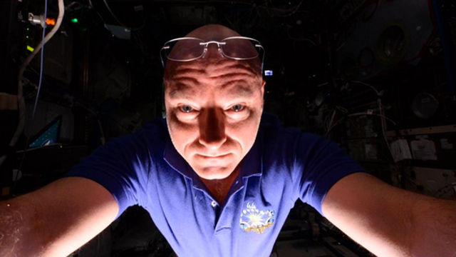 Astronaut shows what it looks like when you take selfies in space, illuminated by Earth.