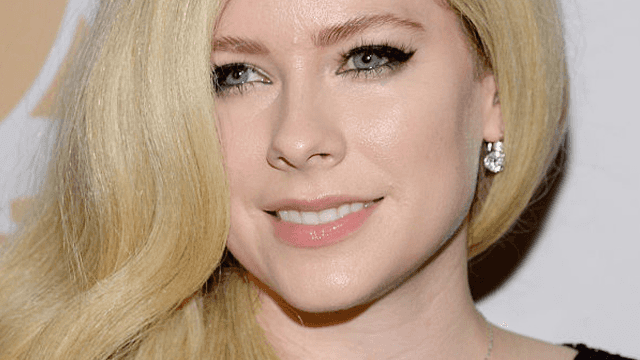 Conspiracy theorists won't let Avril Lavigne tweet.