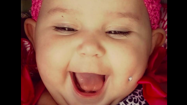 Parents across the internet are furious about this baby's 'cheek piercing.'
