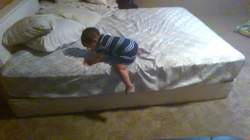 This baby genius figured out how to escape from a bed like a tiny MacGyver.