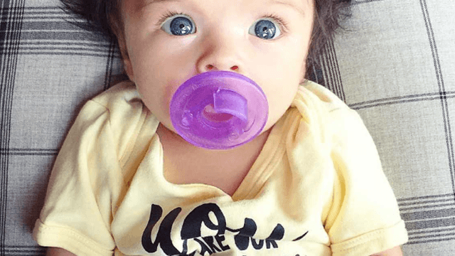 Baby with the craziest mad scientist hair becomes Internet sensation.