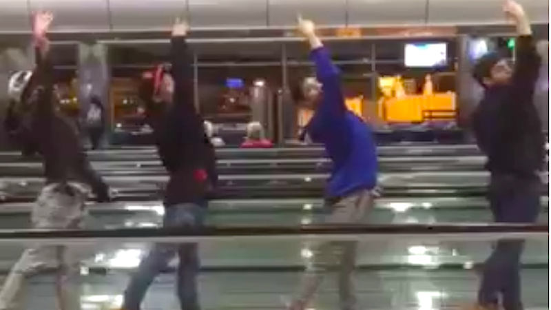 A ballet group stuck in the airport made a beautiful choreographed video on the moving walkways.