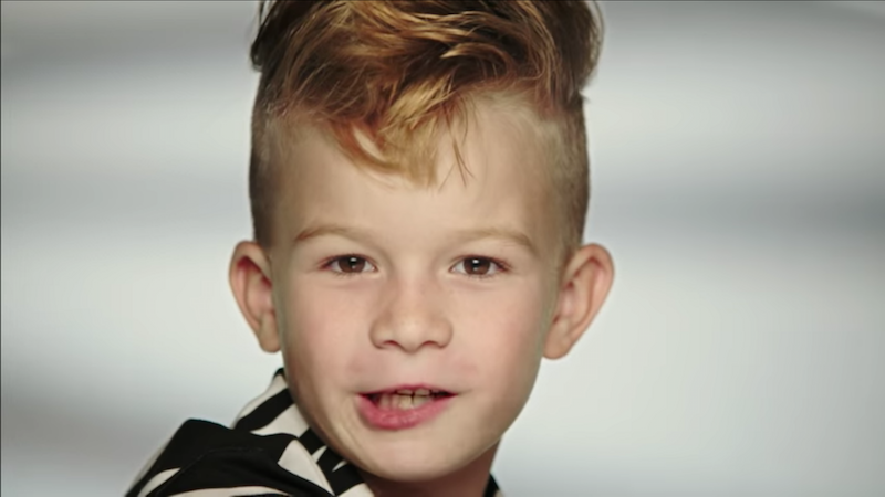 A boy was featured in a Barbie commercial for the first time ever.