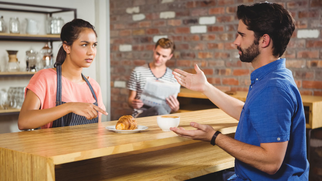 Barista responds to rude customers by pretending to get fired in front of them.