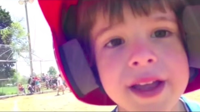Cute little slugger stops game to deliver a very important message to the first base coach.