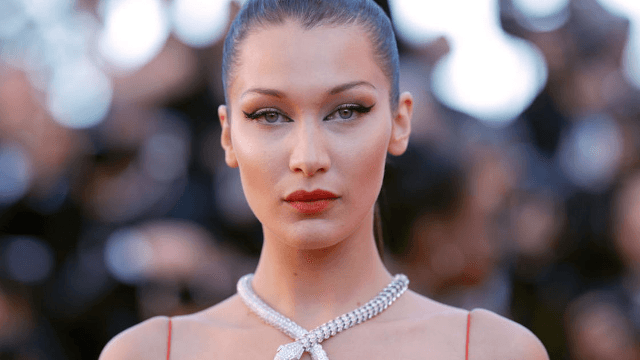 Watch Bella Hadid shut down her bodyguard after he pushed a female photographer.