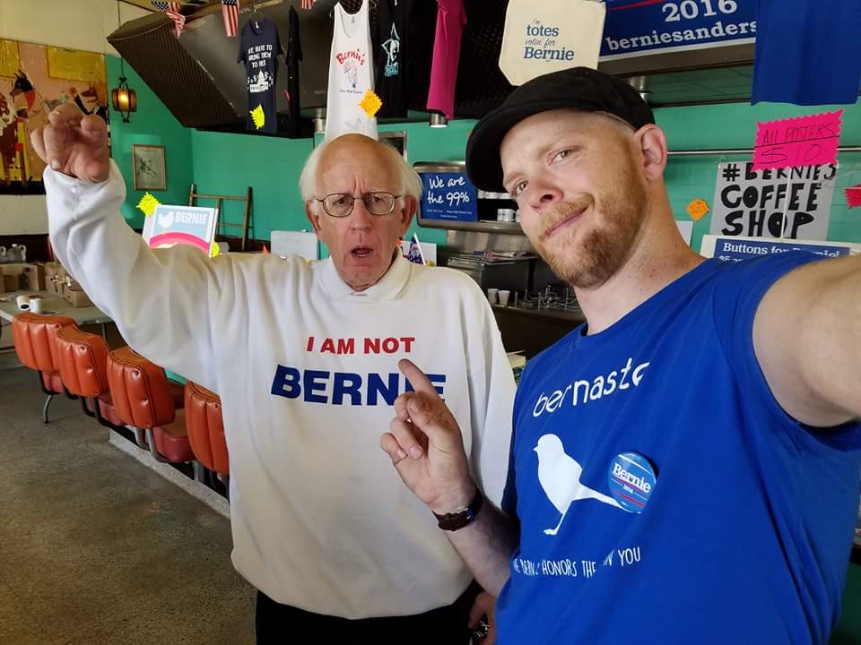 This guy looks so much like Bernie Sanders he has to use a shirt to keep from being mobbed.