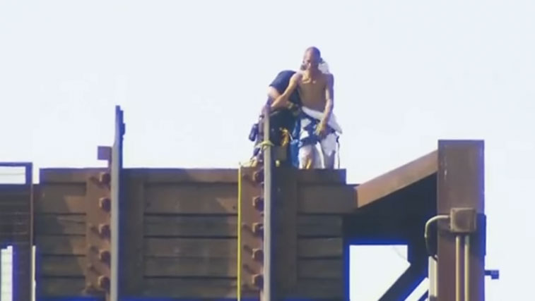 Bet you can guess which state this naked man was in when he got himself stuck on a drawbridge.