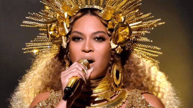 ICYMI: Beyoncé wore a dress with her own face on it at the Grammys.