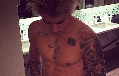 Bieber responds on Instagram to claims that Calvin Klein photoshopped his penis and pecs.