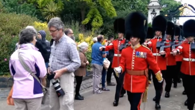 """""""Stupid man!"""" Big ol' meanies in Queen's Guard nearly trample hapless tourist."""